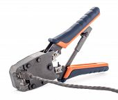 stock photo of cat5  - Crimping tool for twisted pair on a white background isolated - JPG