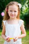 Portrait of charming little girl outdoors
