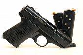 Semi Auto Handgun And Magazines