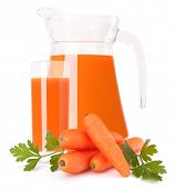 Carrot vegetable juice in glass jug isolated on white background cutout