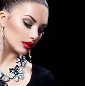 Beauty Woman with Perfect Makeup and luxury accessories.