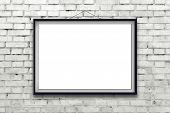 foto of wall painting  - Blank horizontal painting poster in black frame hanging on white brick wall - JPG