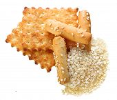 Sesame cookies and seeds on a white background