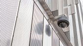 picture of cctv  - Security camera CCTV in front of the building for close monitoring - JPG