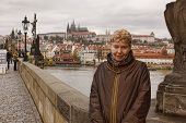 Middle-aged Woman Smiling On The Charles Bridge