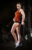 Young sporty woman in orange skirt (dark version)