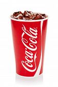 ESTONIA-AUGUST 16, 2014.Coca-Cola with ice cubes in cup, isolated on the white background.Coca-Cola