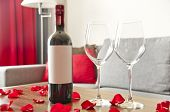Wine Bottle, Two Glasses And Rose Petals On A Table - Romantic Afternoon
