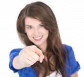 Isolated Portrait Of Young Smiling Businesswoman Pointing With Index Finger Over White.