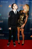 NEW YORK-AUG 20: Model Heidi Klum (R) and comedian Taylor Williamson attend the post-show red carpet for 'America's Got Talent' Season 9 at Radio City Music Hall on August 20, 2014 in New York City.