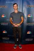 NEW YORK-AUG 20: Hand-balancer Andrey Moraru attends the backstage post-show red carpet for NBC's 'America's Got Talent' Season 9 at Radio City Music Hall on August 20, 2014 in New York City.
