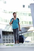 Cool Guy Walking With Suitcase And Bag