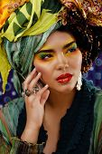 beauty bright woman with creative make up, many shawls on head like cubian