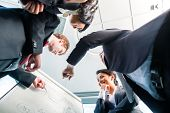 Low angle view of business partners looking at flipchart