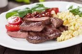 Beef steak with pasta and red kidney beans