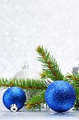 Firtree and christmas decor on glitter silver background