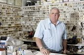 stock photo of locksmith  - Portrait of locksmith in store - JPG