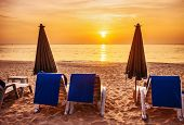 chairs and umbrellas on white beach in sunset time at Phu Quoc island in Vietnam
