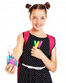 A picture of a happy schoolgirl with set of school stationary
