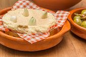 French Camembert With Cloves Of Garlic