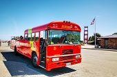 Sightseeing Tour Bus At The Golden Gate Bridge In San Francisco