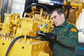 industrial worker during heavy industry machinery assembling on production line manufacturing worksh