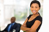happy attractive african businesswoman in office