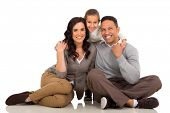 cheerful couple with their little daughter on white background