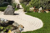 foto of sand lilies  - view of a zen garden with sand - JPG