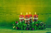 Traditional Advent Wreath Or Crown With Four Red Burning Candles.