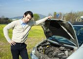 picture of breakdown  - young man and car breakdown problem in countryside - JPG