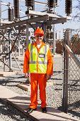 handsome senior technician standing in power plant