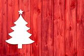 Red Wooden Christmas Background With A White Tree.
