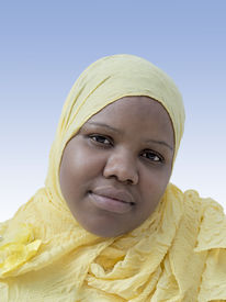 stock photo of plumper  - Portrait of a voluptuous woman wearing a headscarf - JPG