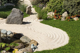stock photo of sand lilies  - view of a zen garden with sand - JPG