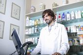 Pharmacist Using A Computer.