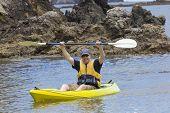 Man enjoying an ocean kayaking trip