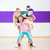 picture of health center  - Children in zumba class dancing modern group choreography  - JPG