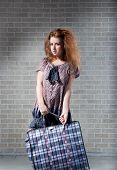 Tired Redhaired Woman With Shopping Bag.