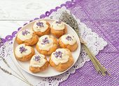 eclairs with lavender custard cream on wooden background