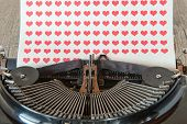 Old Typewriter With Red Hearts On Paper