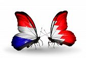 Two Butterflies With Flags On Wings As Symbol Of Relations Holland And Bahrain