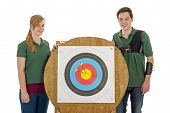 Boy And Girl Standing Besides Archery Target