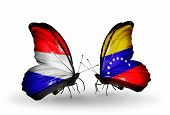 Two Butterflies With Flags On Wings As Symbol Of Relations Holland And Venezuela