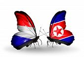 Two Butterflies With Flags On Wings As Symbol Of Relations Holland And North Korea