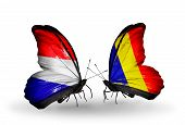 stock photo of holland flag  - Two butterflies with flags on wings as symbol of relations Holland and Romania - JPG