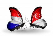 Two Butterflies With Flags On Wings As Symbol Of Relations Holland And Singapore