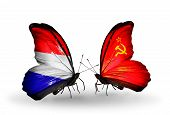 foto of holland flag  - Two butterflies with flags on wings as symbol of relations Holland and Soviet Union - JPG