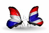 foto of holland flag  - Two butterflies with flags on wings as symbol of relations Holland and Thailand - JPG