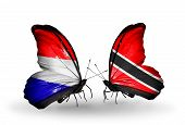 Two Butterflies With Flags On Wings As Symbol Of Relations Holland And Trinidad And Tobago